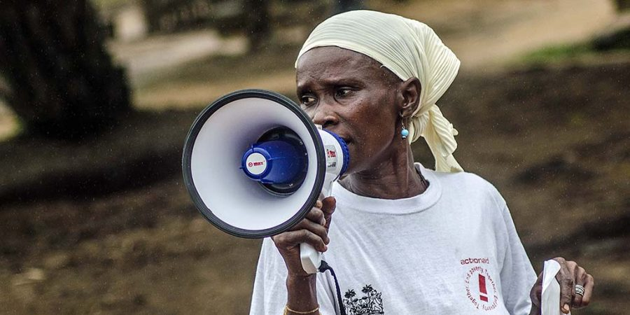ActionAid volunteer facilitator Hawa Jalloh conducts an Ebola awareness session.
