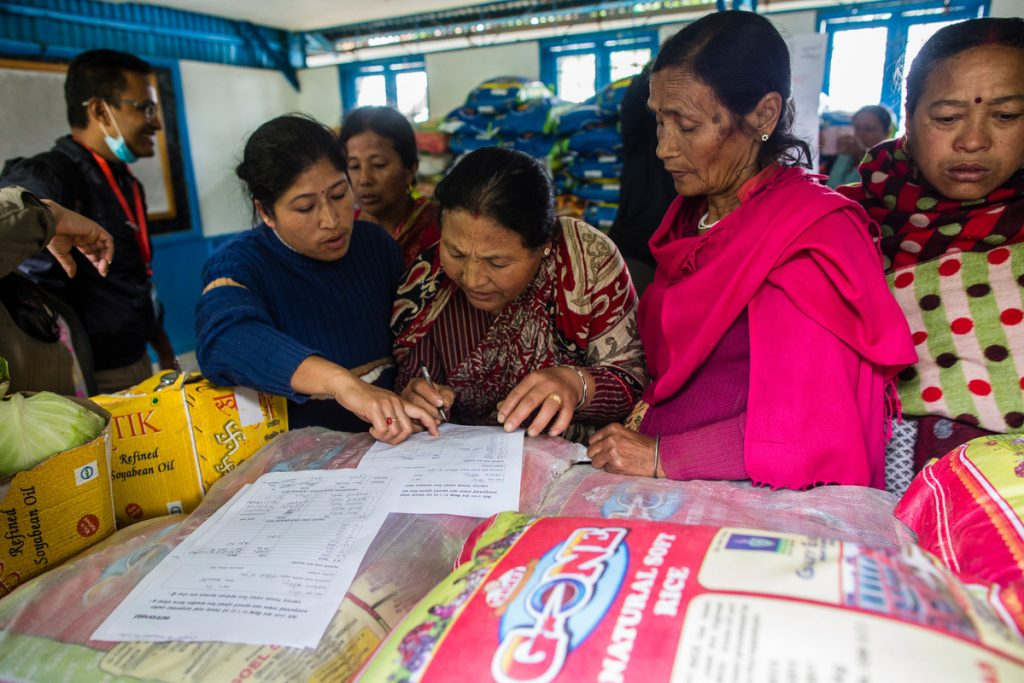 A local women's network supported by ActionAid coordinates an aid delivery. Photo: Prashanth Vishwanathan