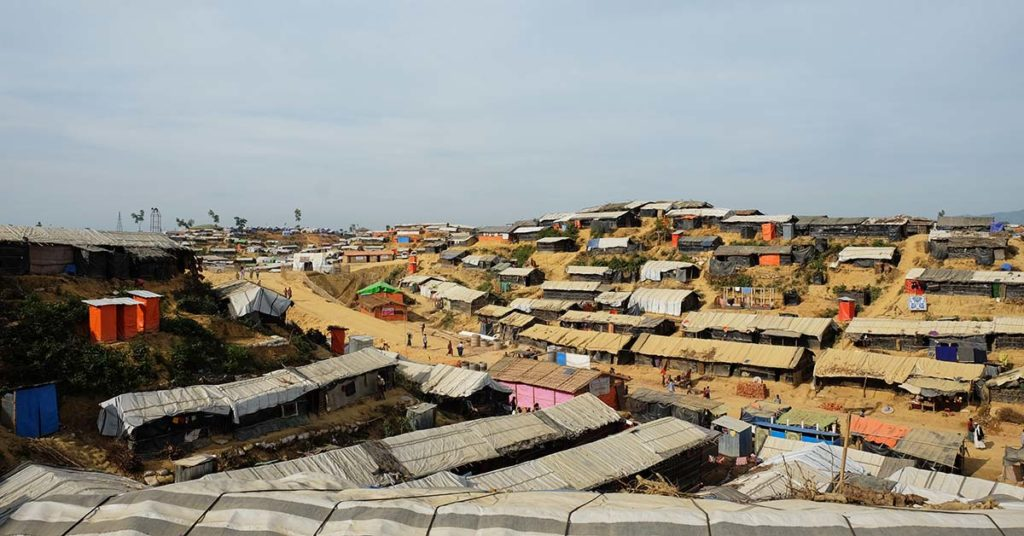 Dozens of shacks made with bamboo and tarpaulin lining a slope in Cox's Bazar, Bangladesh, offer a sense of safety to the Rohingya refugees staying there.
