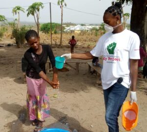 Activista member, right, demonstrating proper hand washing techniques to stop the spread of coronavirus