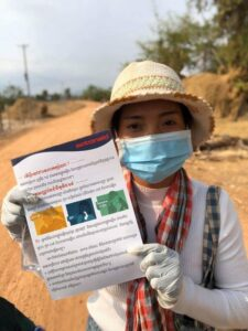 One of our partners in Cambodia distributes flyers on coronavirus prevention communities.