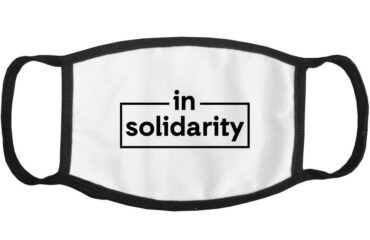 "ActionAid USA face mask with the words ""In Solidarity"""