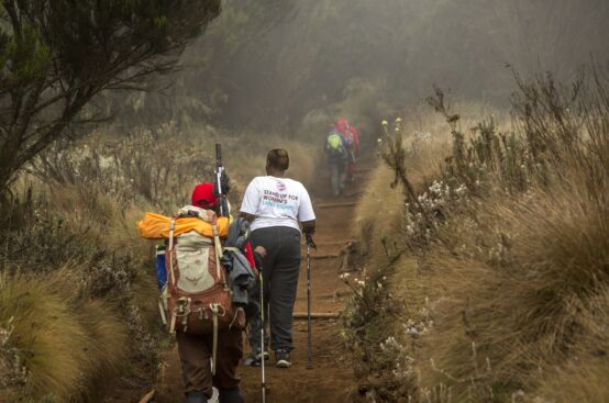 Cecilia, a farmer from Kenya, climbs Kilimanjaro's slopes. Photo: Georgina Goodwin/ActionAid