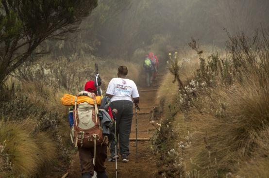 Cecilia, a farmer from Kenya, climbs Kilimanjaro's slopes. Photo: Georgina Goodwin/ActionAid