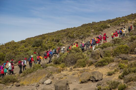 African women farmers and their guides head toward Kilimanjaro's summit. Photo: Georgina Goodwin/ActionAid