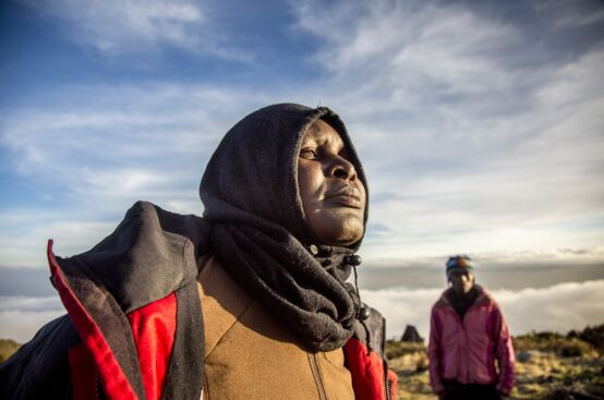 Mary, a farmer from Kenya, takes in Kilimanjaro's summit. Photo: Georgina Goodwin/ActionAid