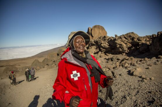 Polly, farmer and women's rights activist from Uganda, makes her way towards Kibo Hut, close to Kilimanjaro's summit. Photo: Georgina Goodwin/ActionAid