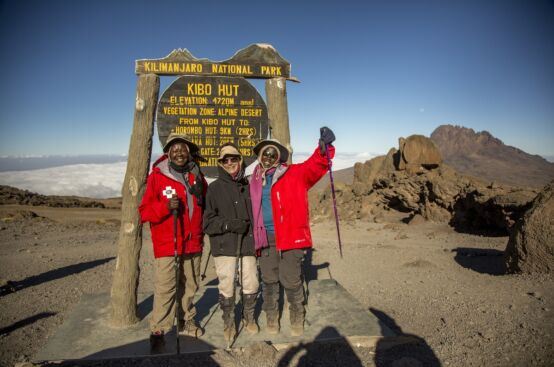 Polly and Irene, rural women's leaders and farmers from Uganda, at Kibo Hut, 4,720 m. up Kilimanjaro with Lyn, who climbed the mountain in solidarity with them. Photo: Georgina Goodwin/ActionAid