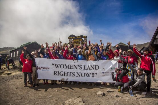 African women farmers and solidarity trekkers. Photo: Georgina Goodwin/ActionAid