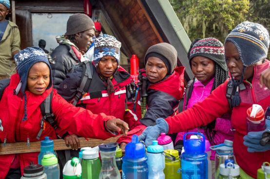 Climbers restock on supplies as they continue their ascent. Photo: Georgina Goodwin/ActionAid