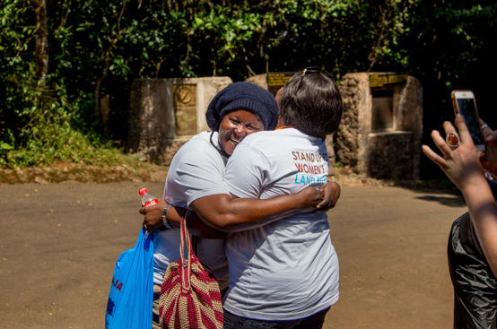 Mary, Kenyan land rights advocate, is greeted after her descent. Photo: Georgina Goodwin/ActionAid